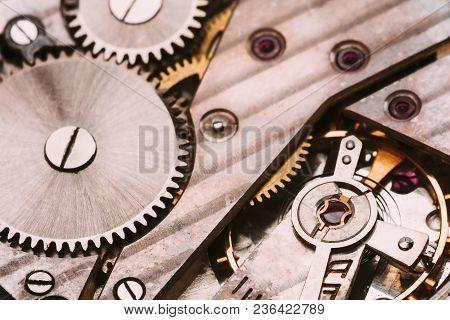 Old Retro Clockwork Background. Clock Watch Mechanism With Gray And Golden Gears. Vintage Mechanism