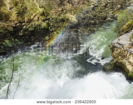 Rainbow Over Saut Du Doubs Waterfall In The Region Of Doubs Switzerland