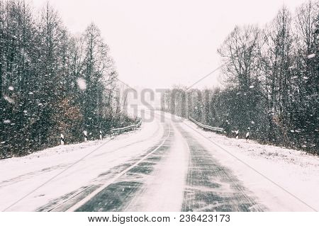 Snow-covered Open Road During A Winter Snowstorm. Adverse Weather Conditions.