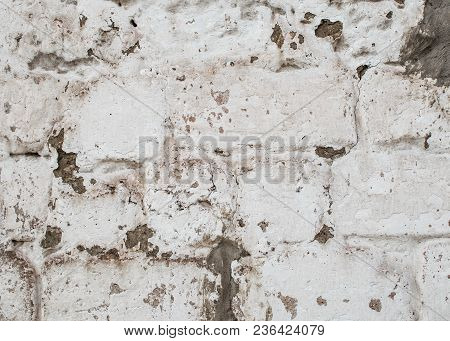 White And Gray Pink Old Brick Wall With Cracks Background.