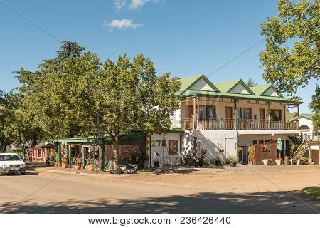 Clarens, South Africa - March 12, 2018: A Street Scene With A Guest House, Restaurant And Art Galler