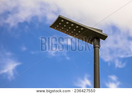 Led Street Light With Black Pole And Armature Aigainst Blue Summer Sky