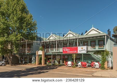 Clarens, South Africa - March 12, 2018: A Street Scene With The Vitos Restaurant And Pub In Clarens