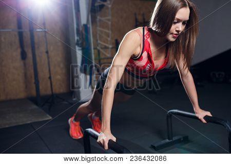 Image of sports woman pushing