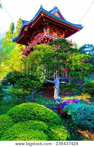 Pagoda Building With Japanese Architectural Design Surrounded By Lush Green Manicured Plants Taken A