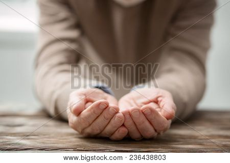 Empty Nest Syndrome. Selective Focus Of An Elderly Mans Hands While Being Shown To You