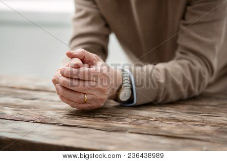Now I Am Lonely. Hands Of A Cheerless Aged Man Being Put On The Table While Suffering From Lonelines