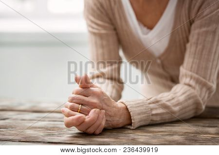 My Memories. Nice Aged Woman Looking At Her Wedding Ring While Remembering Her Husband