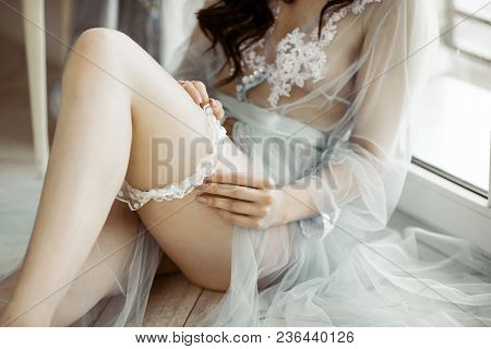 Beautiful Sexy Lady In Elegant Blue Robe And Garter. Close Up Female Fashion Portrait Of Model Indoo