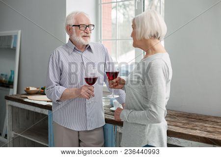 Wedding Anniversary. Cheerful Delighted Couple Looking At Each Other While Celebrating Their Wedding