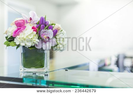 Interior Of Reception At The Clinic With Beautiful Flowers In Vase