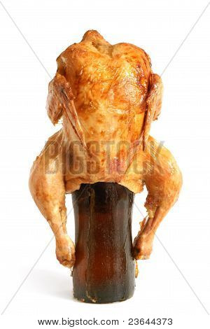 Marinated and roasted chicken on a beer bottle on a white background poster