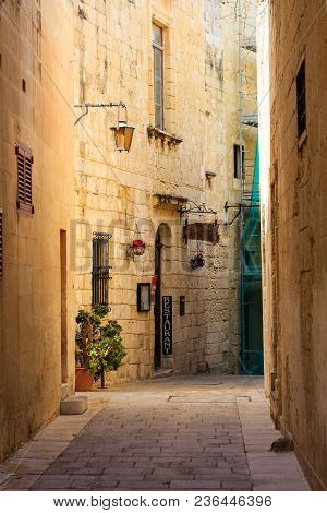 Malta, Mdina. A Restaurant In The Old Medieval City With The Narrow Streets And The Sandstone Facade