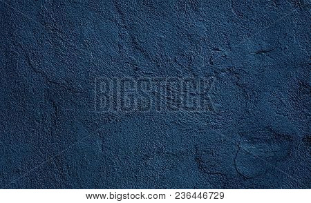 Beautiful Abstract Grunge Decorative Relief Navy Blue Background. Rough Stylized Plaster Wall Textur