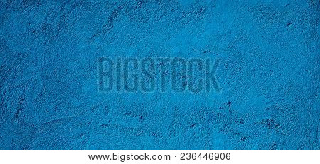 Beautiful Abstract Grunge Decorative Navy Blue Stucco Wall Background. Wide Angle Rough Stylized Tex
