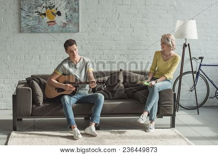 Boyfriend Playing Acoustic Guitar For Girlfriend At Home