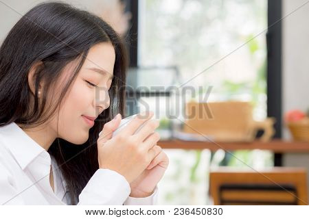 Beautiful  Young Asian Woman Drinking Coffee And Smile In The Morning At Cafe, Girl Sitting In Coffe