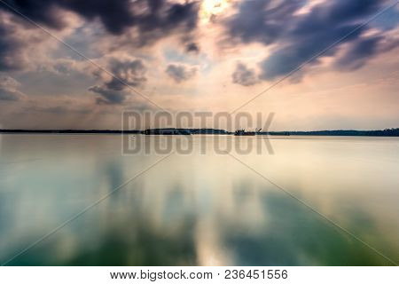 Beautiful Long Exposure Sunrise Shot At Jetty. Image Contain Certain Grain Or Noise And Soft Focus W