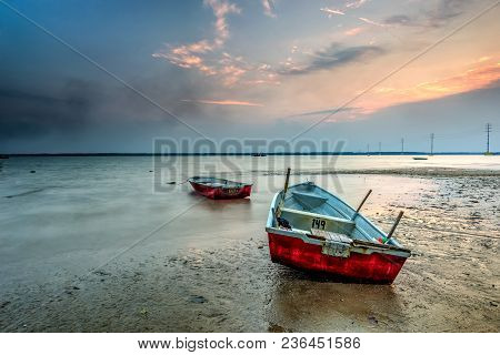 Beautiful A Long Exposure Picture Of Sunset Over A Fishing Boat