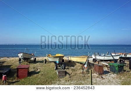 Helsingborg, Sweden - 14 April, 2018: The beach north from Helsingborg on shore of Oresund with landed small boats in spring sunny day