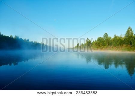 River and fog. Early morning with sunrise. Backlighting