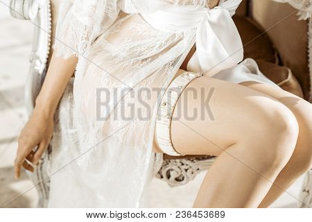 Beautiful Sexy Lady In Elegant White Robe And Garter. Close Up Female Fashion Portrait Of Model Indo