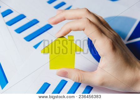 Female Hands Holding Yellow Paper House, Homeless Housing Shelter And Real Estate , Family House Ins