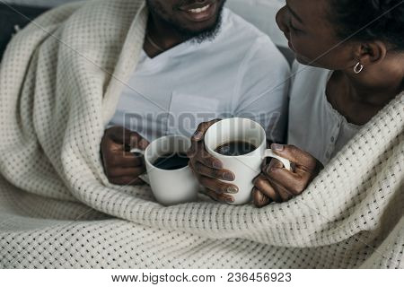 Cropped Shot Of Happy Young African American Couple Drinking Hot Beverage Together At Home