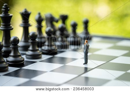 Decision Making Or Leadership In Business Strategy Concept, Brave Miniature Figure Businessman Think