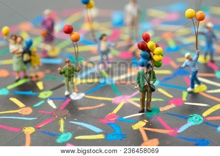Social Network Concept, Miniature People Holding Balloons Standing On Colorful Pastel Chalk Line Lin