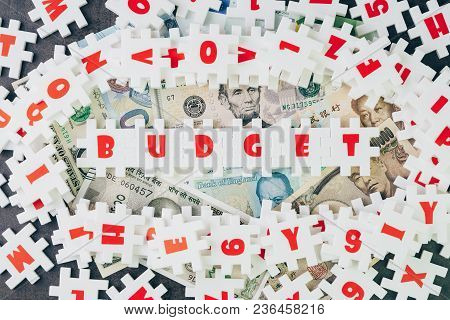 Budget Idea, Abundance White Puzzle Jigsaw With Alphabets Combine Word Budget And Other Letter Piece