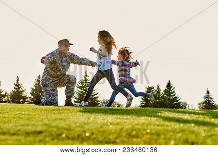 Reunion Of Soldier And Daughters Outdoor On The Lawn. Daddy Came Back From Us Army.