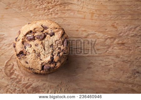 Cookies With Chocolate Chips On A Wooden Table. Top View With Copy Space.