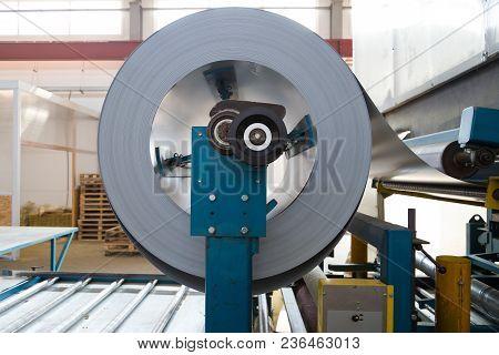 Industrial Metal Sheet Coil For Metal Sheet Forming Machine In Workshop.