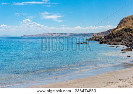 Sea Coastline With Sandy Beach On Sunny Day. Summer Vacation Background