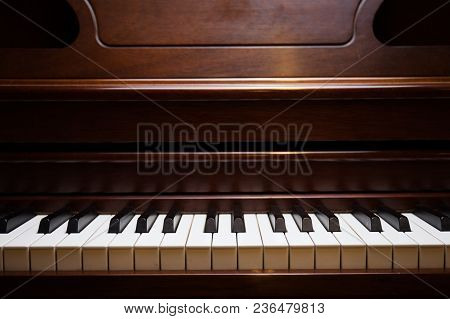 A Photo Of Wooden Piano In A Studio Light