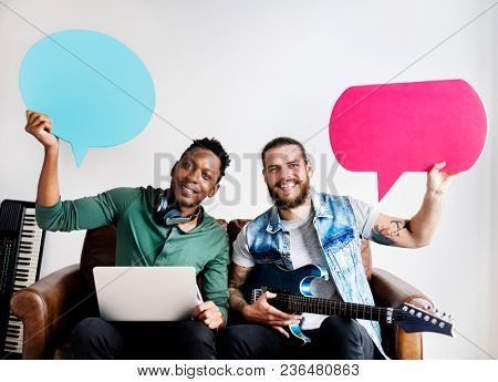 Musicians in a songwriting process holding speech bubbles collaboration and music concept