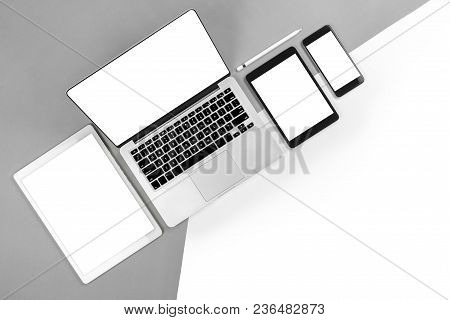 Office Table With Laptop Computer, Digital Tablet, Smartphone, Pencil And Mouse On Isolated Pure Whi