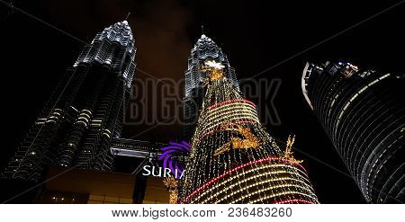 Kuala Lampur, Malaysia - November 2017. Petronas Twin Towers Photographed From Below, The Twin Tower