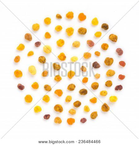 Extreme Close Up Bee Pollen In Creative Layout Pattern Of Round Form. Bee Pollen On White Background