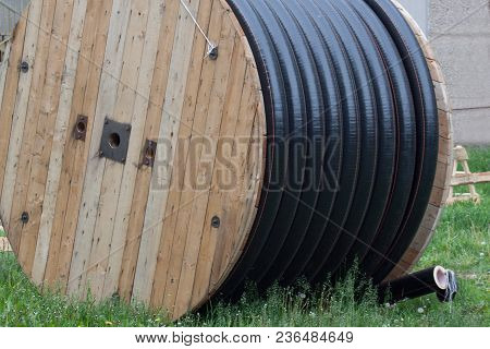 Large Polyethylene Pipes In The Coil For Gas And Water Are Liyng On The Ground. Repair Works.