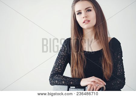 Close-up, Portrait Of A Young Beautiful Woman, Brunette With Long Straight Hair, Long Black Eyelashe