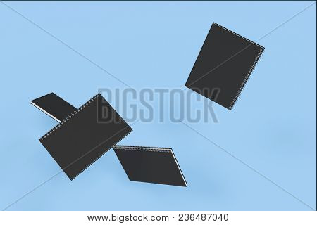 Four Notebooks With Spiral Bound On Blue Background