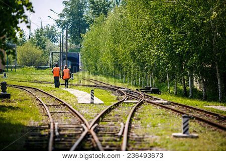 The Way Forward Railway,worker Checking In The Sunny Day