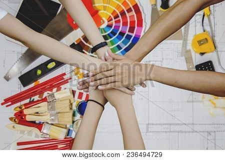 Top View Of Architects Hands Group Of Young Creative Working With Work Tools, Color Swatches And Pai