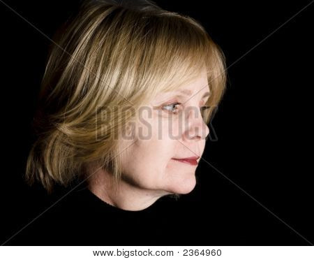 Middle-Aged Woman Lookin Back On Past
