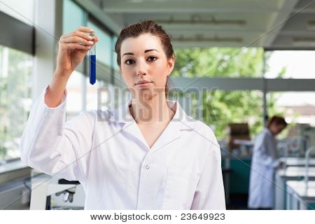 Beautiful Scientist Holding A Test Tube