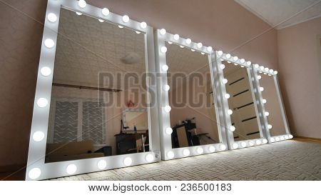 Four Make-up Mirrors Stand In The Room And Are Lit