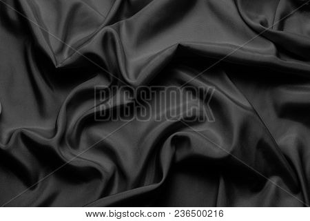 Black Silk With Beautiful Waves. Can Be Used As A Background Or Wallpaper