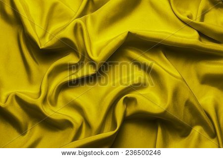 Yellow Silk With Beautiful Waves. Can Be Used As A Background Or Wallpaper